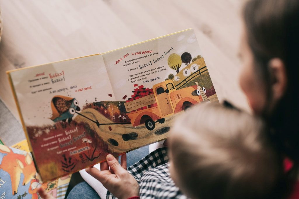 Mother and child reading a picture book.