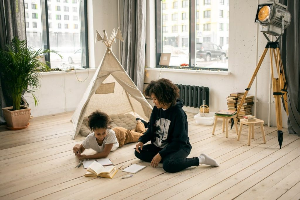 a child reading with his mom