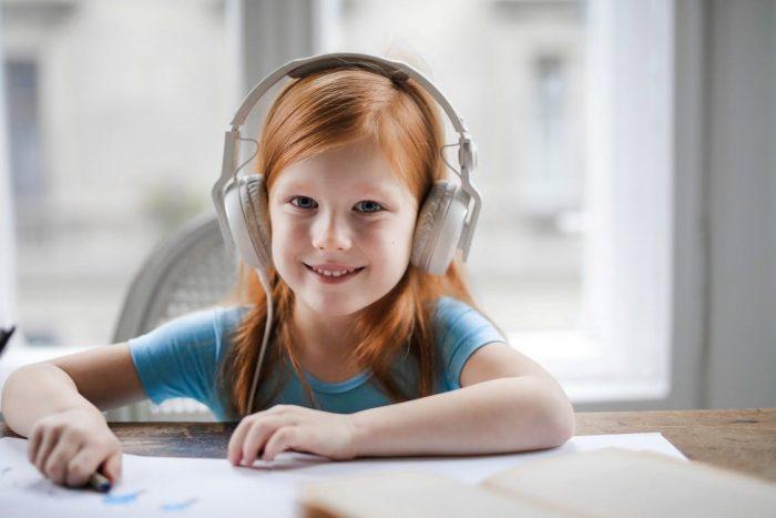 girl listening to a children's book