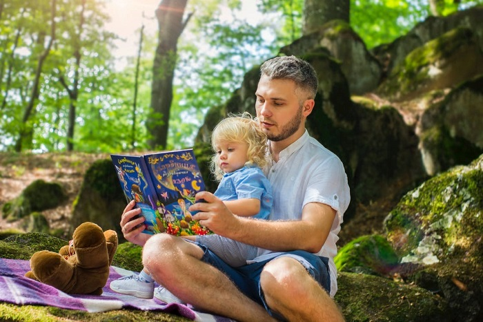 a girl and her dad reading