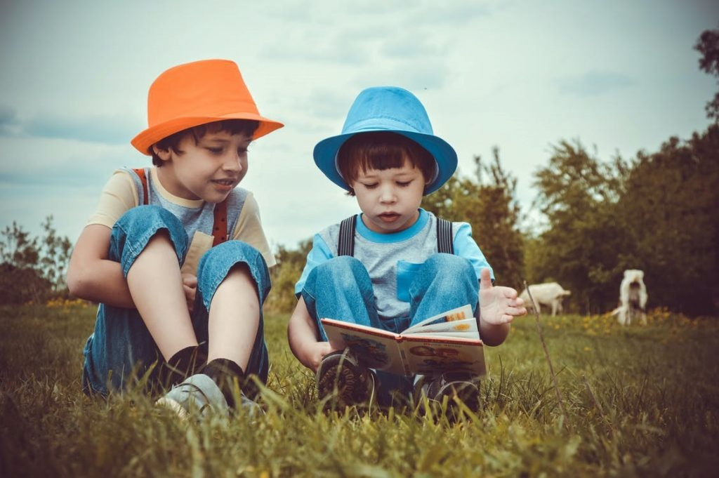 two kids reading a storybook