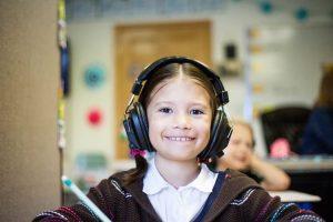 A girl listening to an audiobook