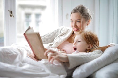 Children reading in bed